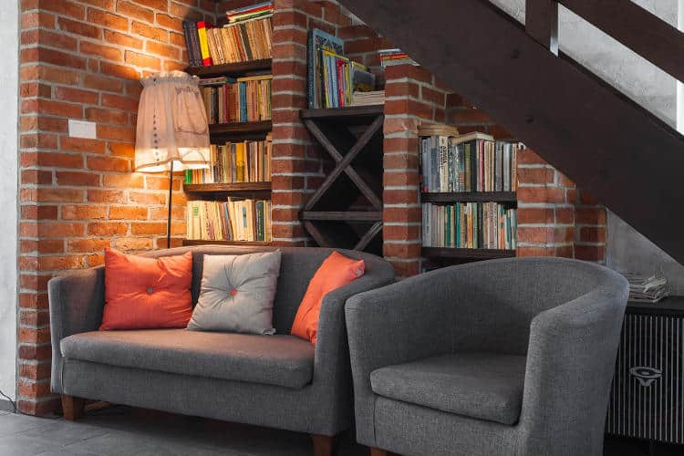 Place sofas and cauches up against a noisy wall. Add bookshelves and other furniture.