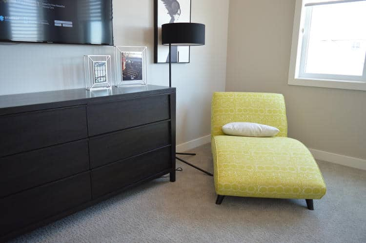 Bedroom sofa and cabinet.