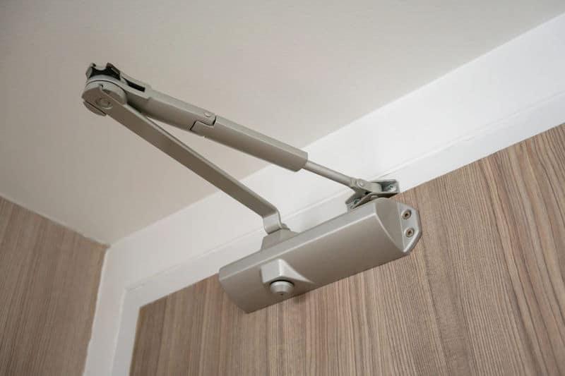 Installing a door closer to prevent slamming of the door.