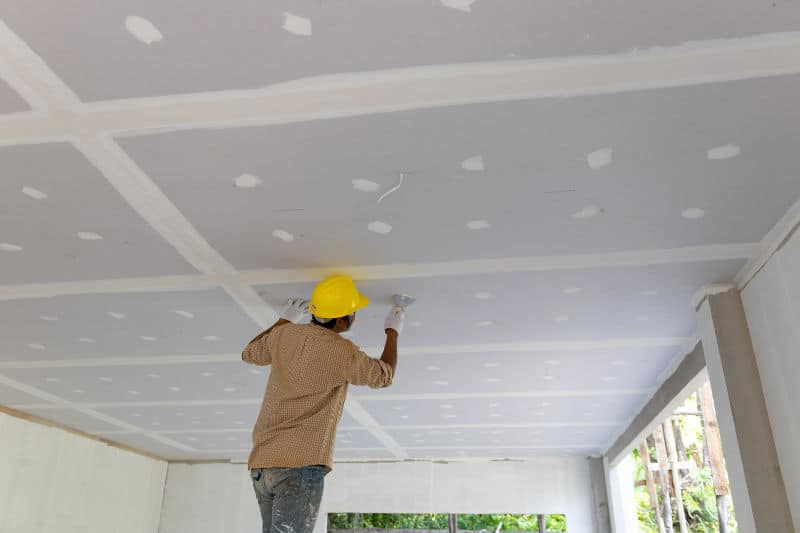 Soundproofing the ceiling with an additional layer of drywall. An effective way to reduce noise from upstairs floors.