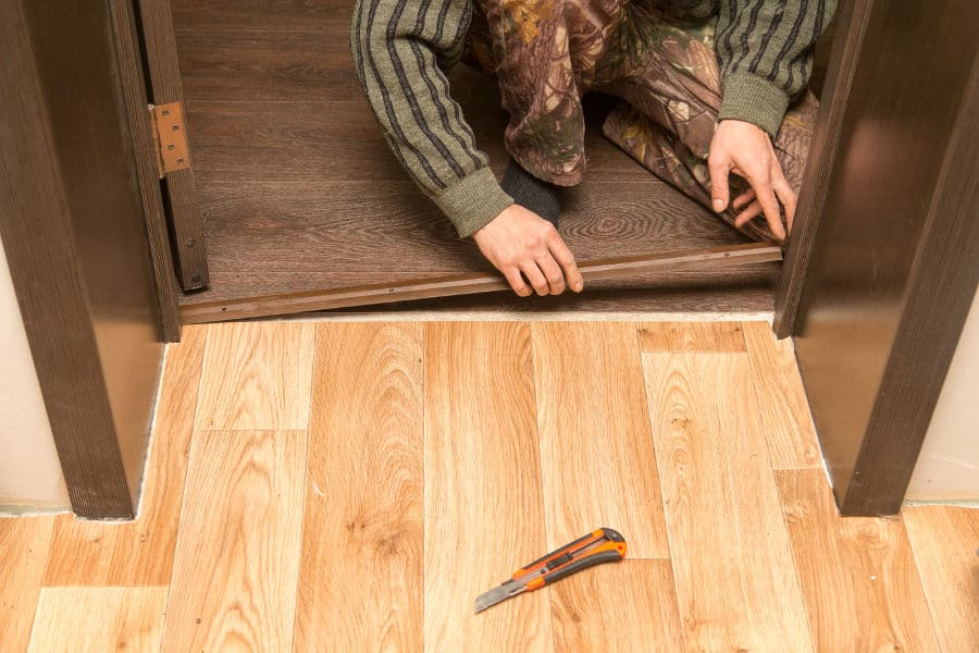 Install a new threshold and seal the bottom of your door.