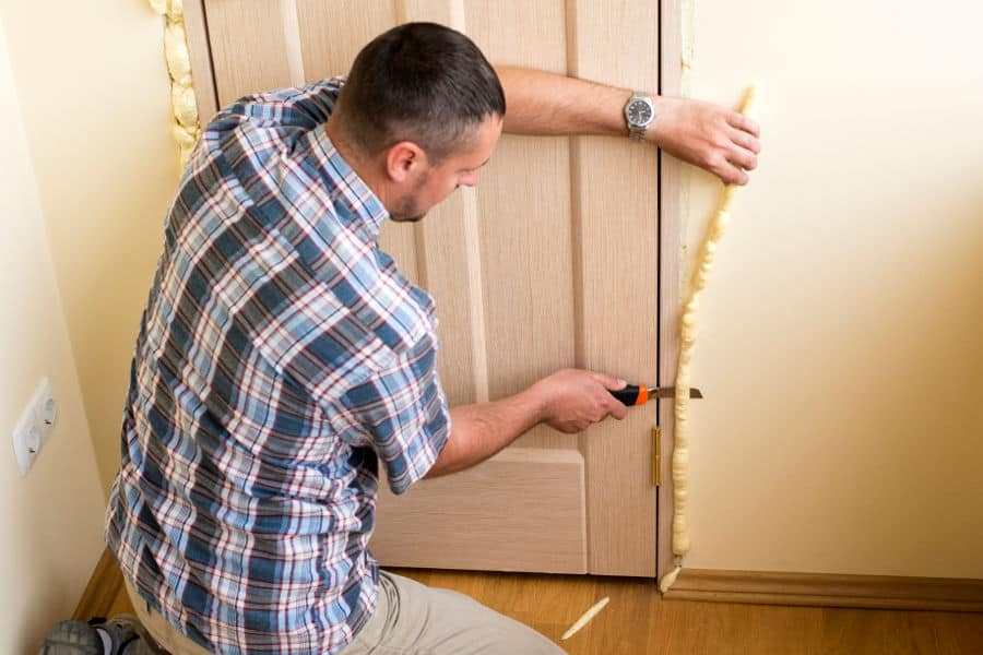 Apply gap foam around the door frame and stop the noise from leaking through.