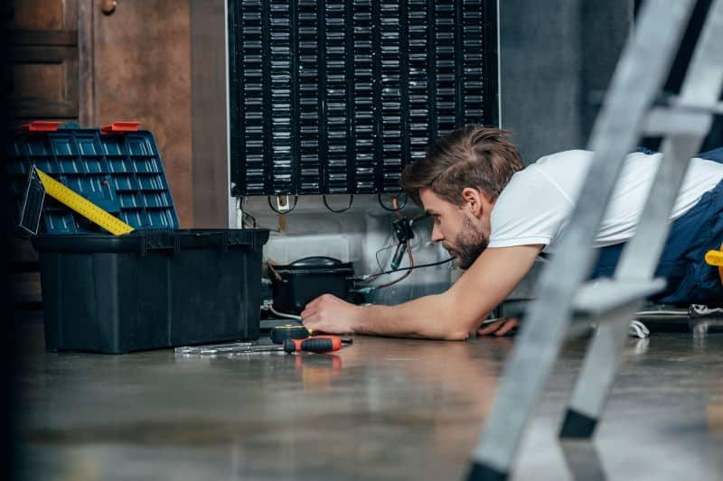Call professionals to fix a noisy refrigerator compressor.
