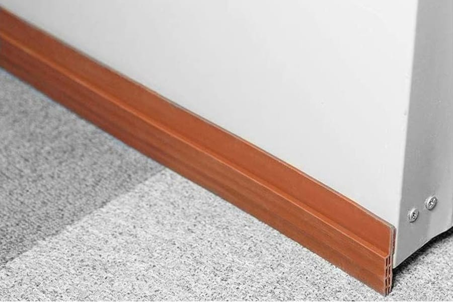The easiest way to close the gap at the bottom of your door is to install a soundproof door sweep.