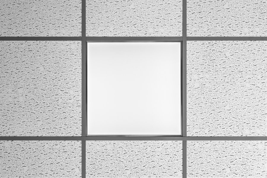 Suspended ceiling with acoustical tiles.