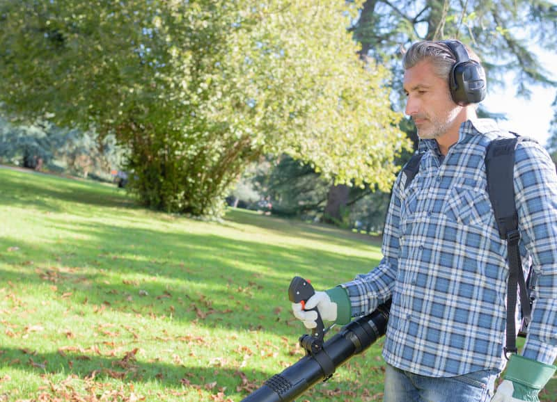 Reduce leaf blower noise with earmuffs.