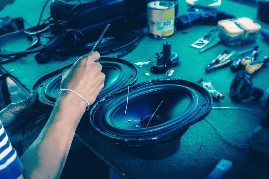 Man fixing speakers.