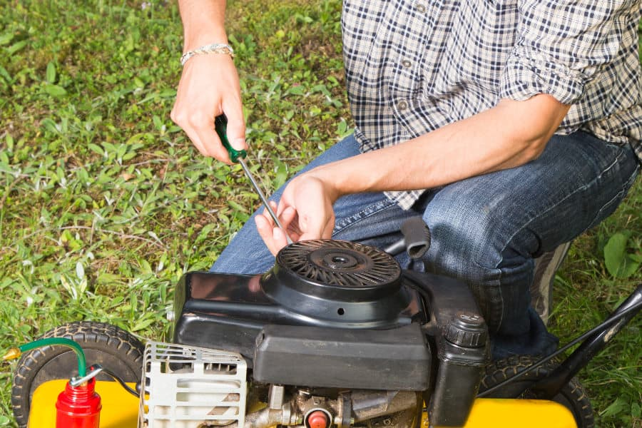 Fixing a noisy lawnmower.