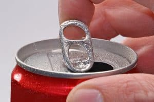 Opening a soda can quietly. 4 best ways to do it.