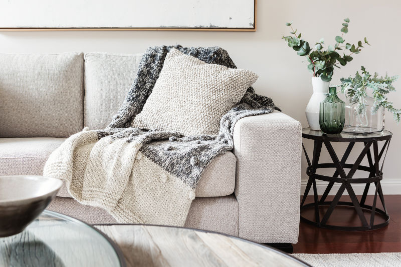 Adding a soft couch can improve the sound in your room.