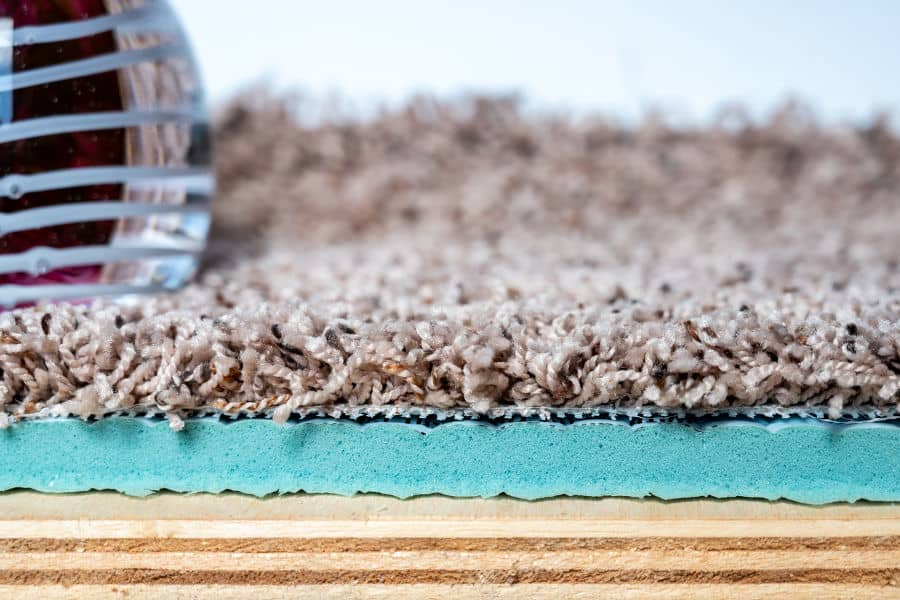 The best way to soundproof a carpeted floor is to add more padding under the carpet.