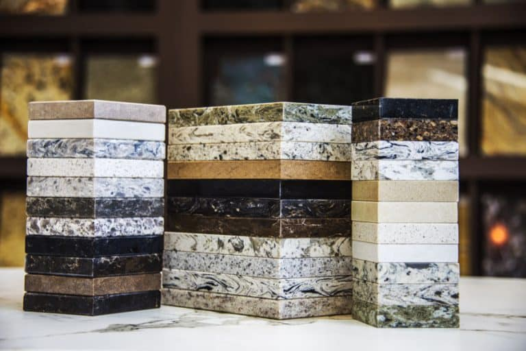 Sound-reflecting materials like granite and marble.