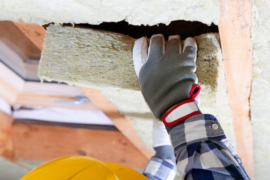 Installing the best basement ceiling insulation materials.
