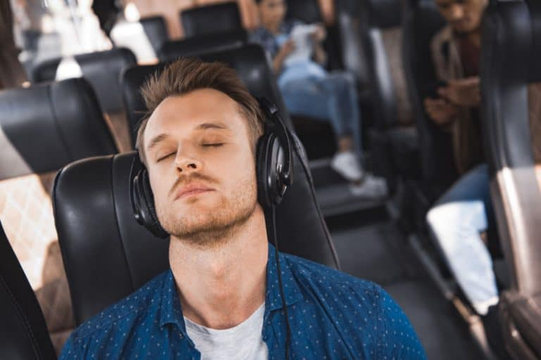 Man wearing noise canceling headphones for blocking voices.