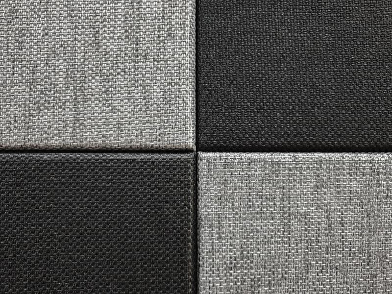 Sound absorbing panels: Fabric-wrapped acoustic panels on a wall.