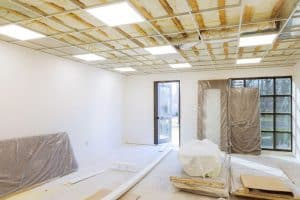 Building a suspended ceiling to soundproof a room.