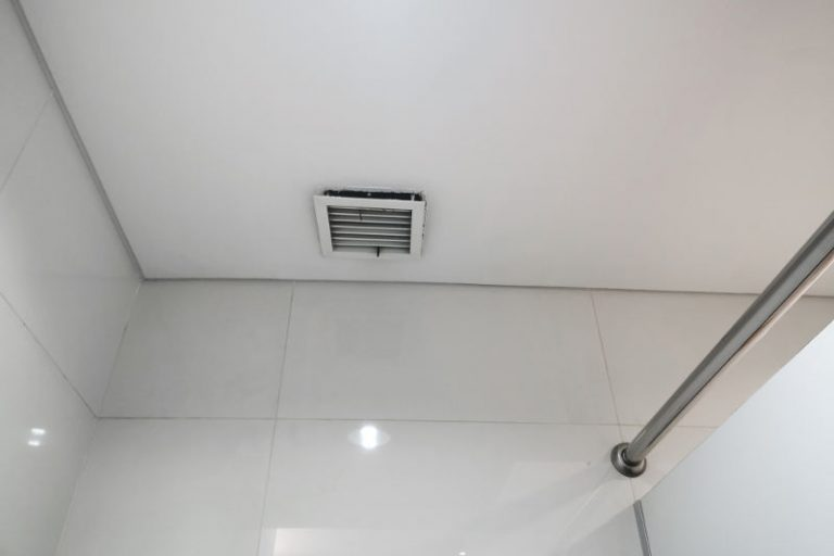 A noisy bathroom fan that needs to be repaired.